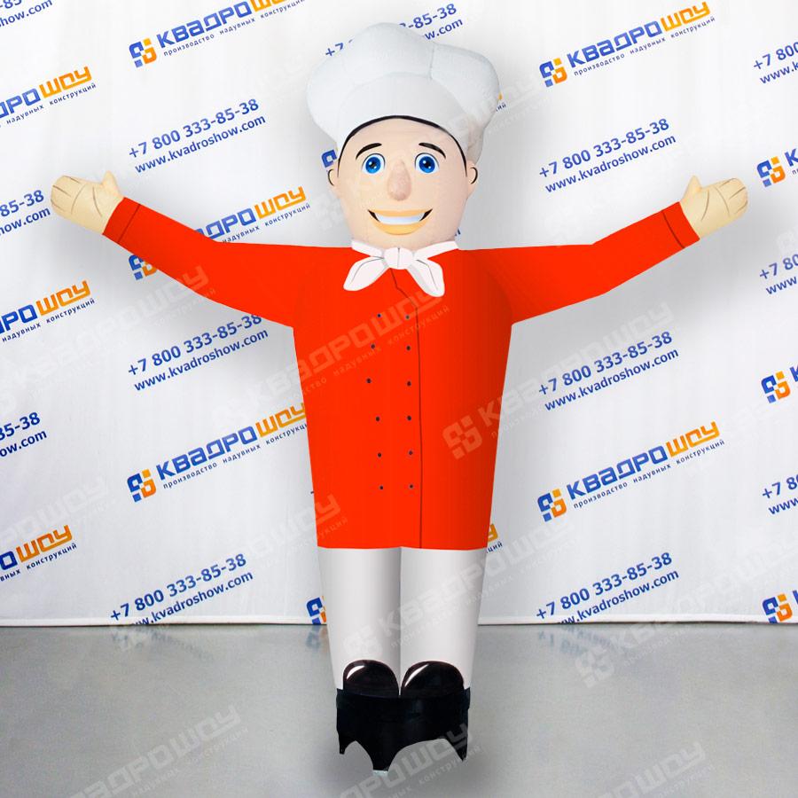 Машущий повар в красном костюме