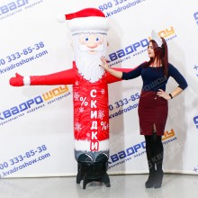 надувная рекламная фигура спортсмен с машущей рукой и сменным баннером